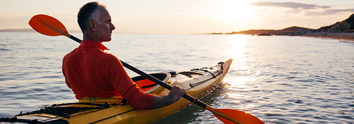 man kayaking after stem cell therapy for spine degeneration